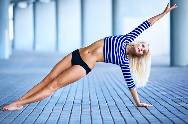 Young slim woman stretching