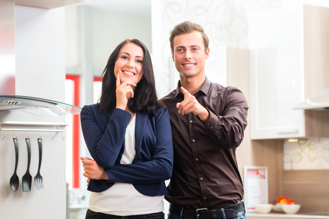Couple buying domestic kitchen furniture store