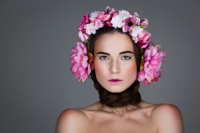 Beautiful girl with floral headphones
